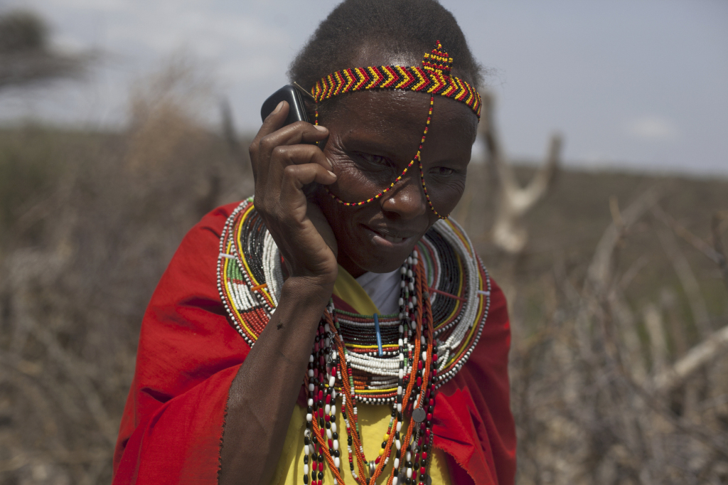 Photo: Mary Kiperus, community health worker, uses a mobile phone for reporting to the local nurse. Leparua village, Isiolo County, Kenya. February, 2014. Christian Aid/Elizabeth Dalziel.